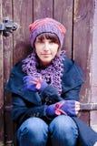 Young woman wearing original gloves Stock Photos