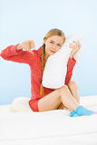 Young woman wearing pajamas hugging soft pillow Royalty Free Stock Image