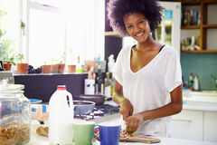 Young Woman Wearing Pajamas Preparing Breakfast In Kitchen Royalty Free Stock Photo
