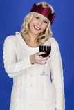 Young Woman Wearing a Party Hat Drinking Red Wine Stock Photos