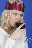 Young Woman Wearing a Party Hat Drinking Red Wine Stock Photography