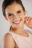 Young woman wearing pearl earrings Royalty Free Stock Photography