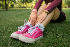 Young woman wearing pink sneakers Royalty Free Stock Photo