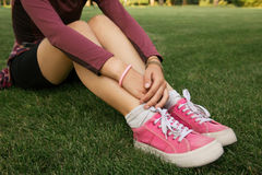 Young woman wearing pink sneakers Stock Image