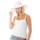 Young woman wearing a pink straw hat Royalty Free Stock Images