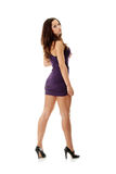 Young woman wearing a purple dress Royalty Free Stock Images