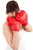 Young woman wearing red boxing gloves Royalty Free Stock Image