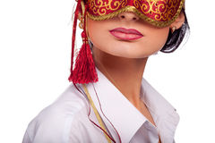 Young woman wearing red carnival mask Royalty Free Stock Photo