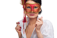 Young woman wearing red carnival mask Royalty Free Stock Photography