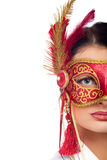 Young woman wearing red carnival mask Stock Photos