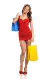 Young Woman wearing a red dress Stock Photo