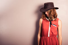 Young woman wearing red dress and cowboy hat Royalty Free Stock Images