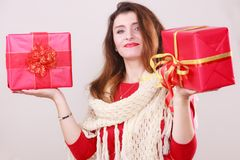 Woman holds red christmas gift boxes Royalty Free Stock Image