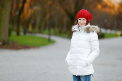 Young woman wearing red hat in autumn Stock Photo