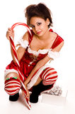 Young woman wearing red Santa costume Stock Images