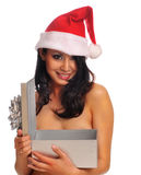 Young woman wearing red Santa hat Stock Image