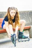 Girl with roller skates outdoor Royalty Free Stock Photo