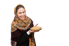 Young woman is wearing russian kerchiefs holds a plate of pancakes royalty free stock photo