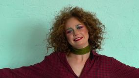 Young woman wearing a 70s retro clothes striking a pose in studio. Disco diva.  stock video footage