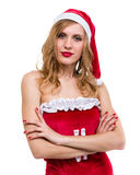 Young woman wearing santa claus clothes posing against isolated white. Background Royalty Free Stock Photos