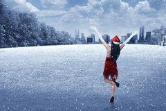 Young woman wearing santa claus costume on the winter field Royalty Free Stock Images