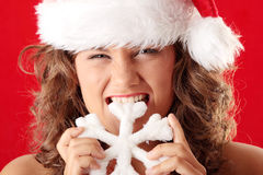 Young woman wearing santa claus hat Stock Photos