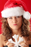 Young woman wearing santa claus hat Stock Photography
