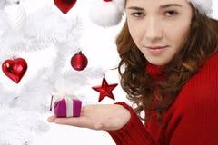 Young woman wearing santa hat Royalty Free Stock Photography