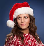 Young woman wearing Santa hat. And festive jumper Royalty Free Stock Photo