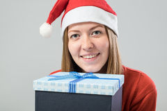 Young woman wearing a santa hat with gift box Royalty Free Stock Photo