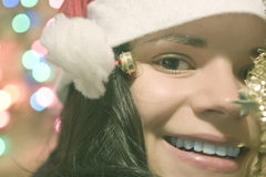 Young woman wearing Santa hat happy for Christmas Royalty Free Stock Image