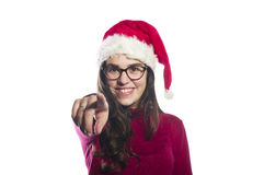 Young woman wearing a santa hat Royalty Free Stock Images