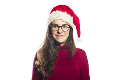 Young woman wearing a santa hat Royalty Free Stock Photos