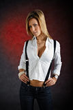 Young woman wearing clothes with suspenders Stock Image