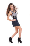 Young woman wearing a short dress royalty free stock image