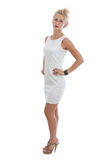 Young woman wearing in a short white dress. Full-length portrait of young woman wearing in a short white dress Royalty Free Stock Images
