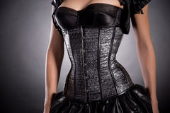 Young woman wearing silver corset with stars Royalty Free Stock Photography