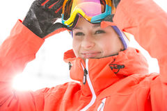 Young woman wearing ski goggles outdoors Royalty Free Stock Images
