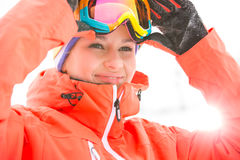 Young woman wearing ski goggles outdoors Stock Photos