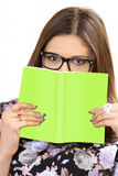 The young woman wearing spectacles holds the book in hand Royalty Free Stock Images