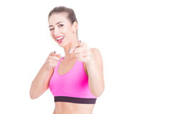 Young woman wearing sport pink bustier winking Stock Image