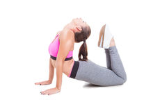 Young woman wearing sportswear stretching her spine Royalty Free Stock Images