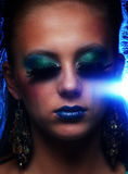Young woman wearing strange make-up with tears Royalty Free Stock Image