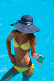Young woman wearing a straw hat Stock Photography
