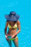 Young woman wearing a straw hat Stock Images