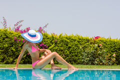 Young woman wearing a straw hat Royalty Free Stock Photography
