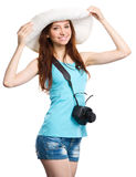 Young woman wearing summer hat. Is preparing for a trip, isolated over white Stock Photography