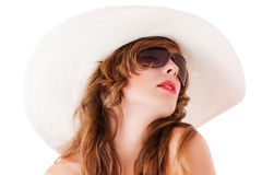 Young woman wearing summer straw hat Stock Images