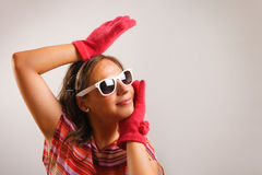 Young woman wearing sun glasses. Modern looking young woman wearing sun glasses Royalty Free Stock Images