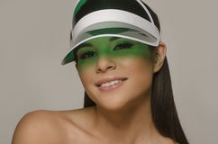 young woman wearing sun visor Royalty Free Stock Image